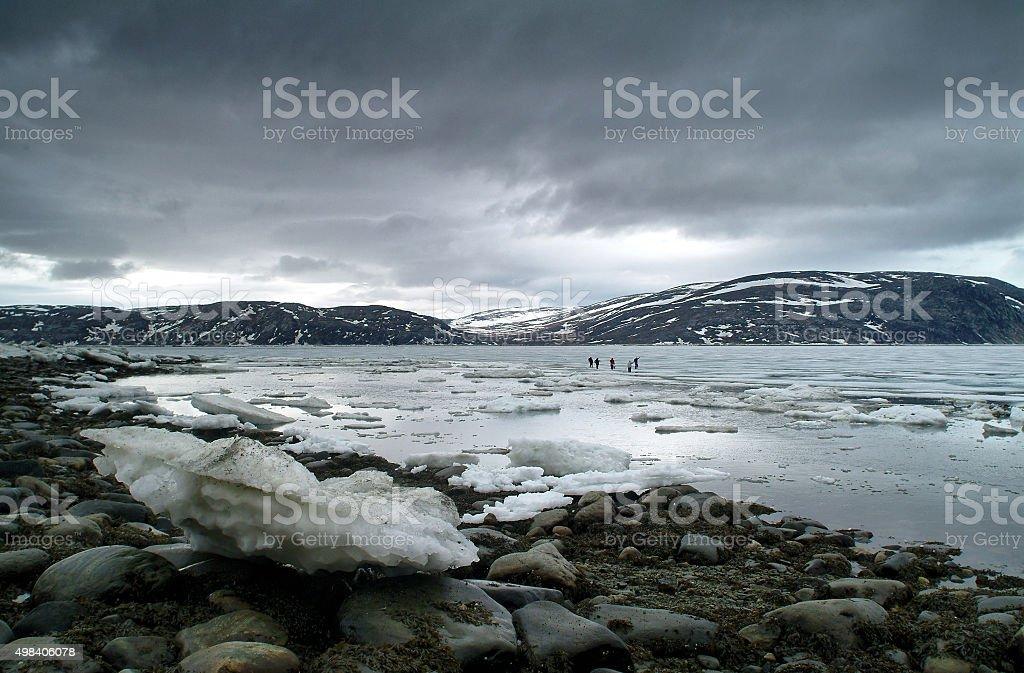 Inuits ice fishing in Nunavik. stock photo