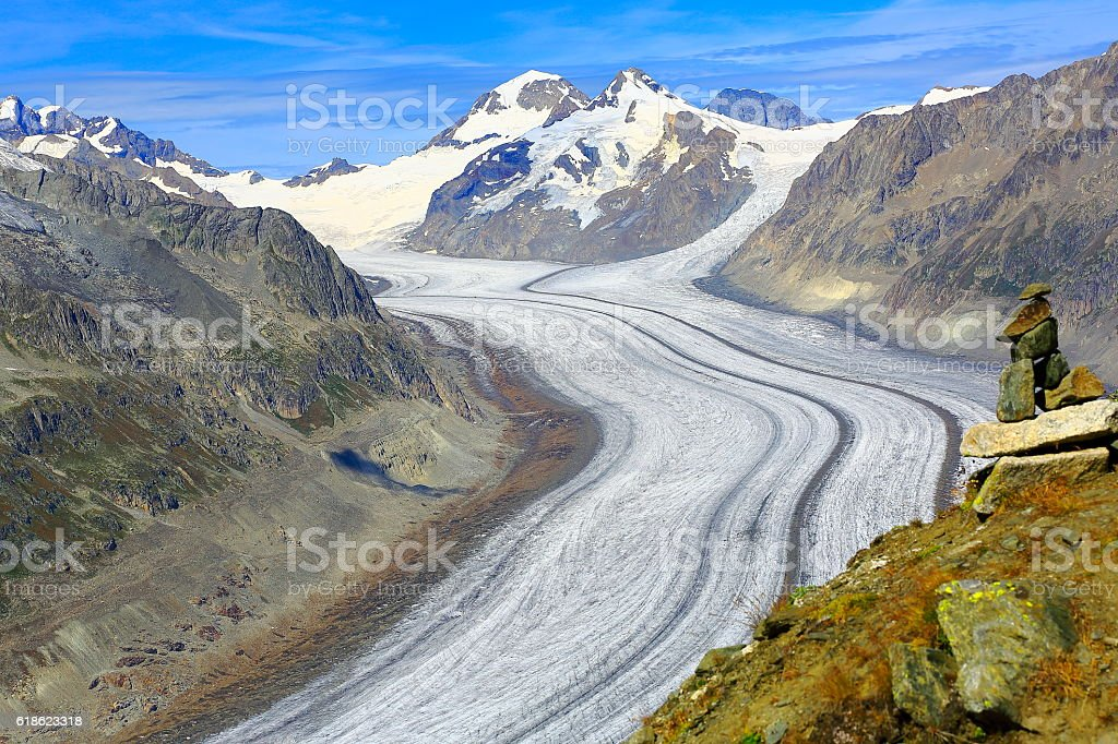 Inukshuk, Aletsch Glacier, Jungfrau, Mönch above Bernese Swiss Alps stock photo
