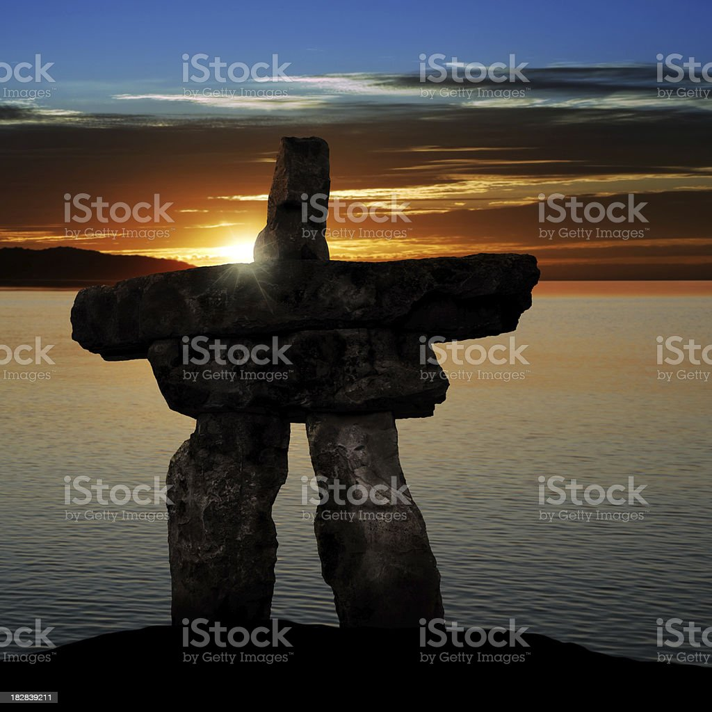 XL inukshuk at sunset royalty-free stock photo