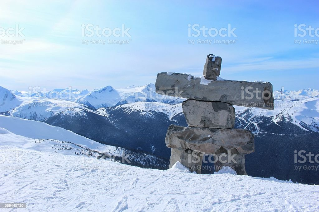Inukshuk in a Mountain Landscape stock photo