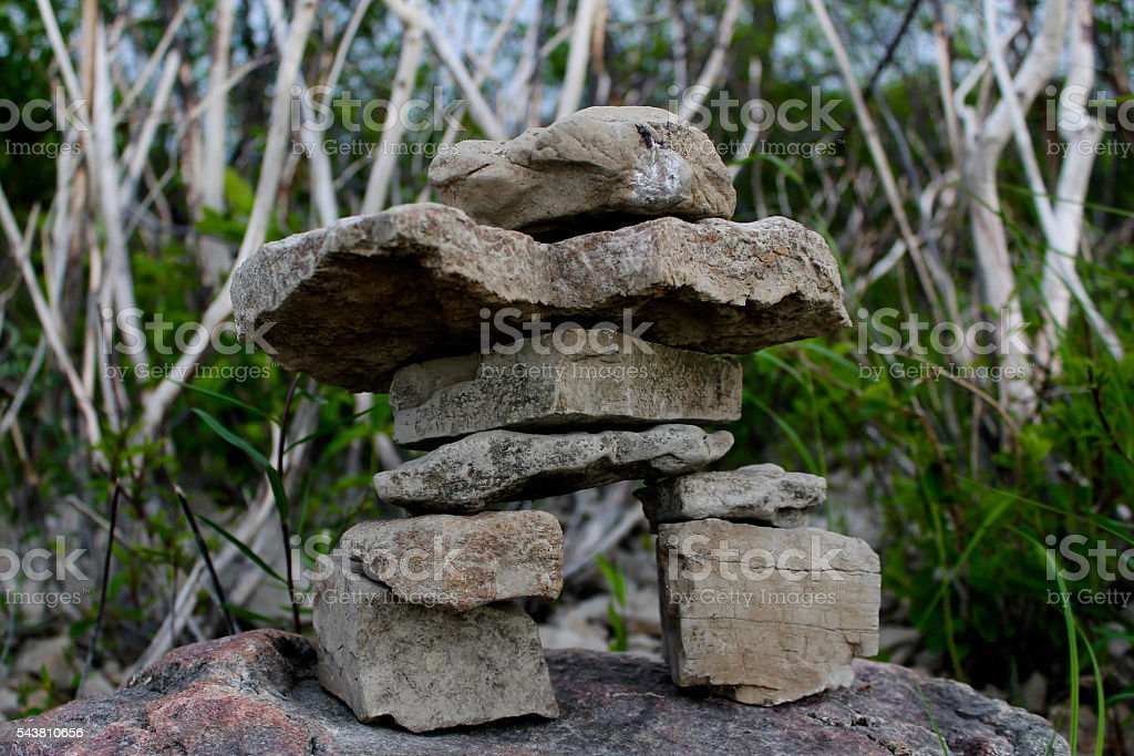 Inukshuk in Front of Branches stock photo