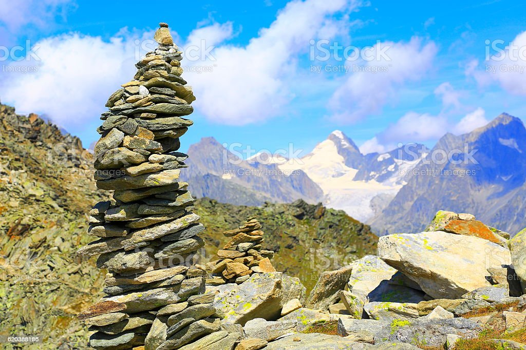 Inukshuk stacked Stones, Bernese Oberland, Eiger and Mönch, Swiss Alps stock photo