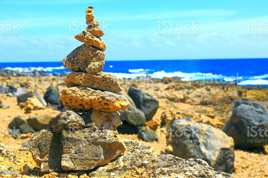 Inukshuk stacked stones on Aruba Beach, Antilles stock photo