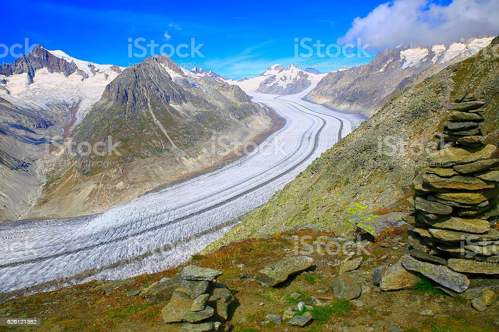 Inukshuk Stones, Aletsch Glacier crevasses, Eiger and jungfrau, Swiss Alps stock photo