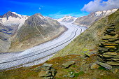 Inukshuk Stones, Aletsch Glacier crevasses, Eiger and jungfrau, Swiss Alps