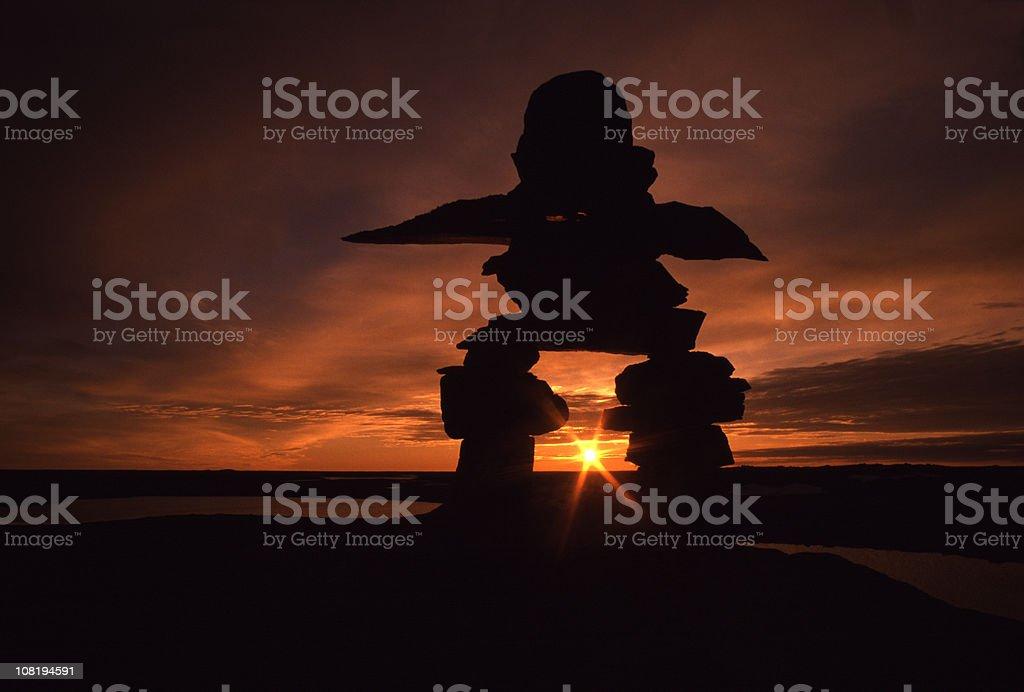 Inuksuk in Land of the Midnight Sun (Inukshuk) royalty-free stock photo