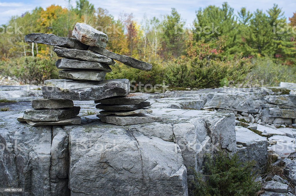 Inuksuk on a rock platform stock photo