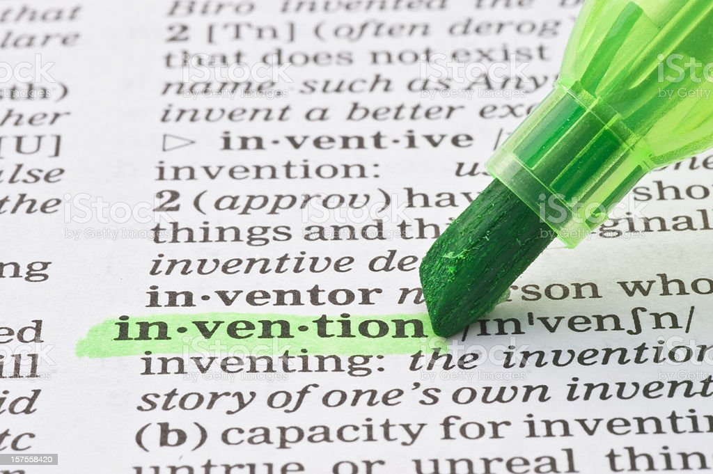 invention highligted in dictionary stock photo