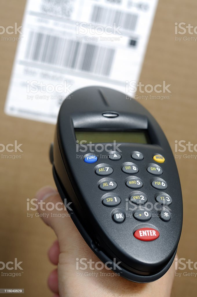 Inventory Barcode Scanner, Person's Hand, and Bar Code Label Box royalty-free stock photo