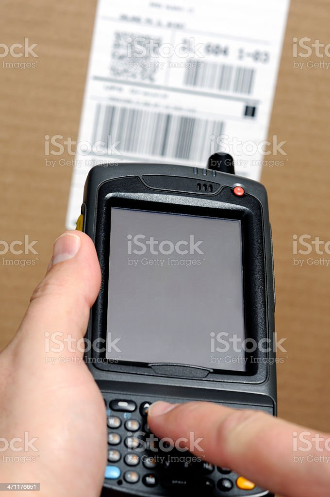 Inventory Barcode Scanner with Person Typing on Keypad stock photo