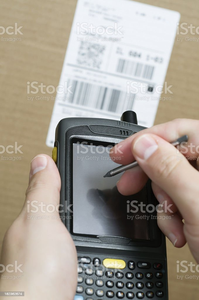 Inventory Barcode Scanner with Person Using Touchpad stock photo