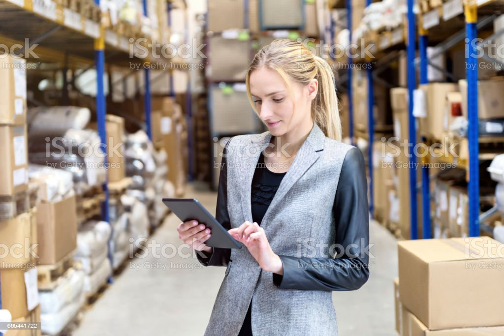Inventory & digital tablet stock photo
