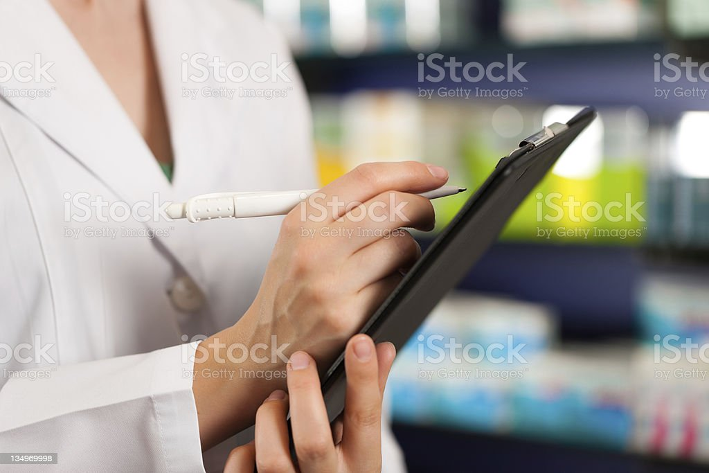 Inventory or order taking in pharmacy stock photo
