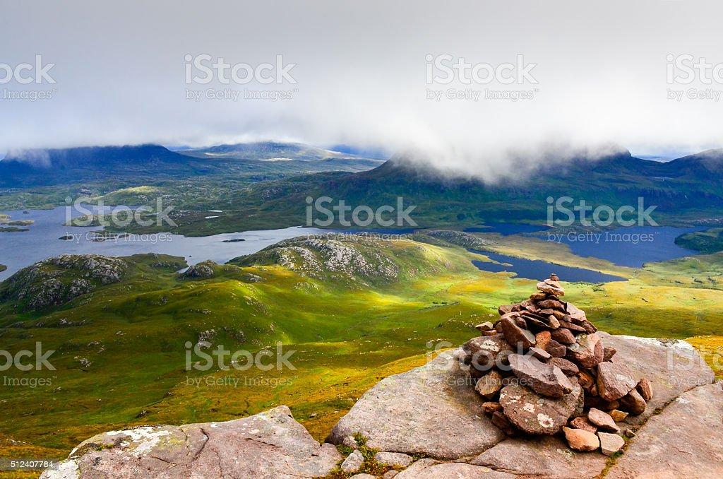 Inverpolly wilderness landscape with small stone pyramid, Scotla stock photo