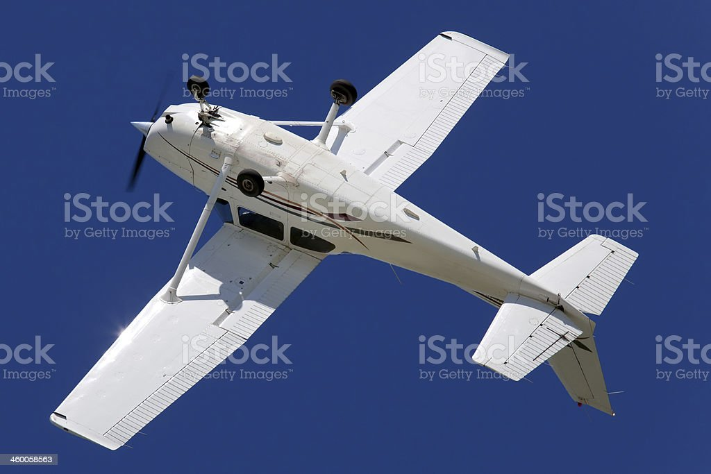 Inverted airplane banking during a roll stock photo