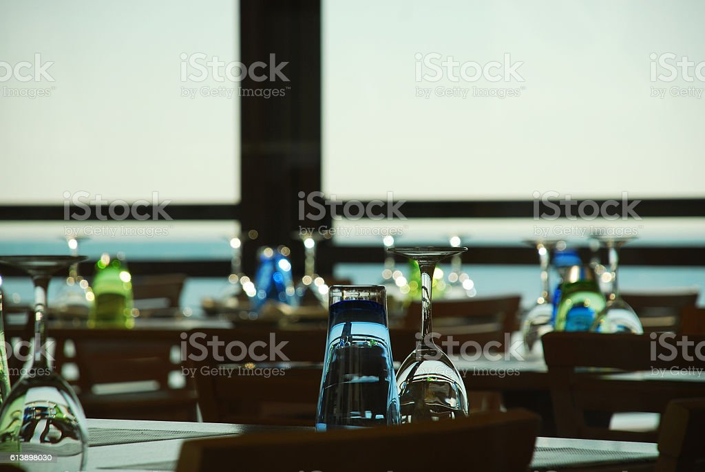 Inverted cups and wine glasses stock photo