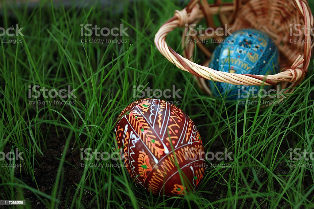 Inverted easter basket with eggs on a grass royalty-free stock photo