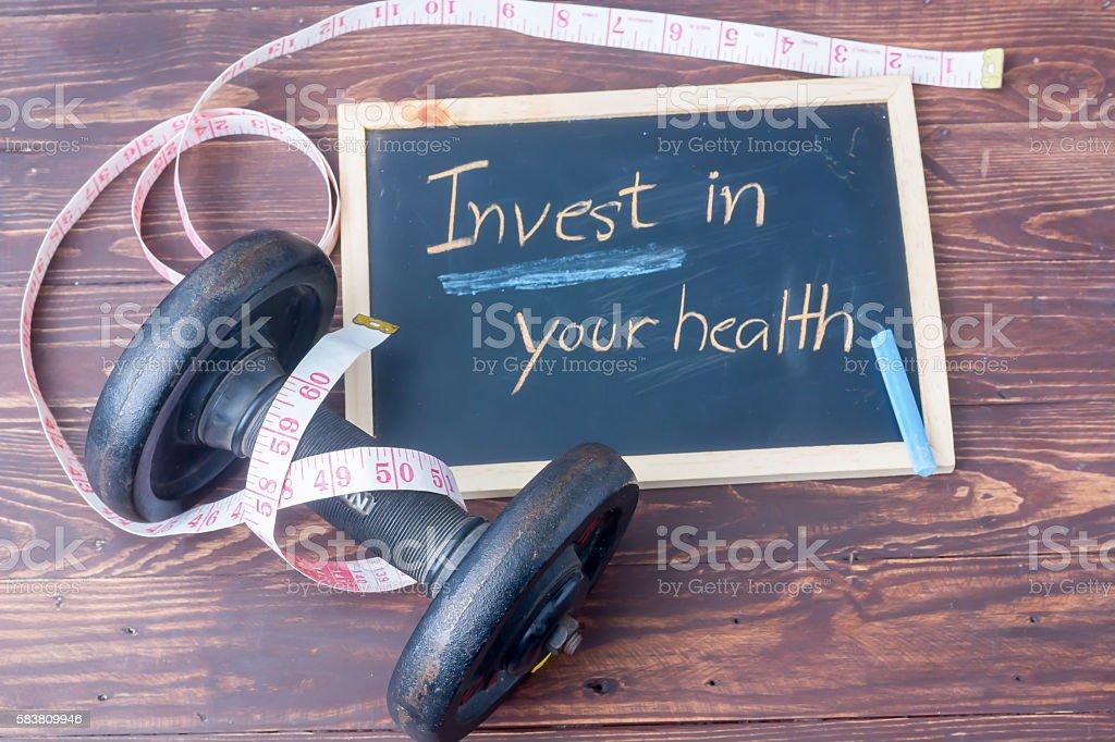 Invest in your health - slate blackboard stock photo