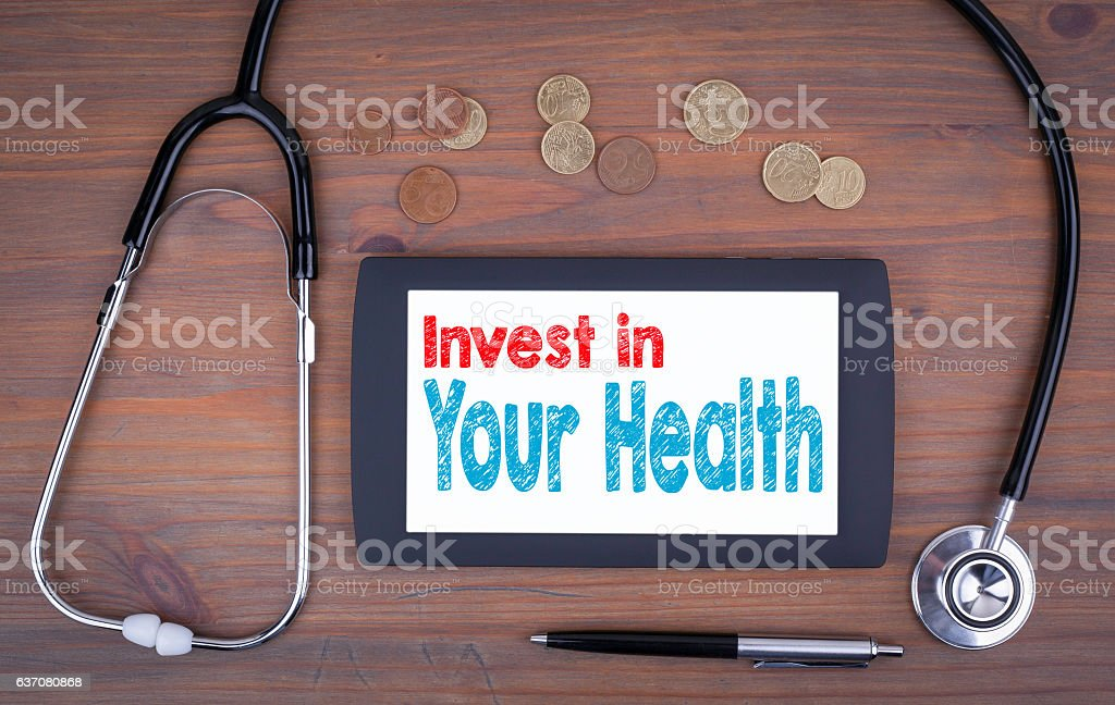 Invest in your health. Text on tablet device stock photo
