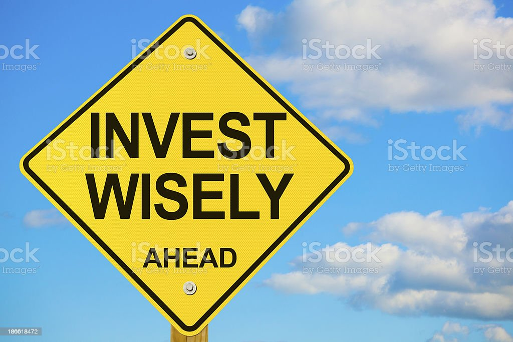 Invest Wisely Ahead Road Sign royalty-free stock photo
