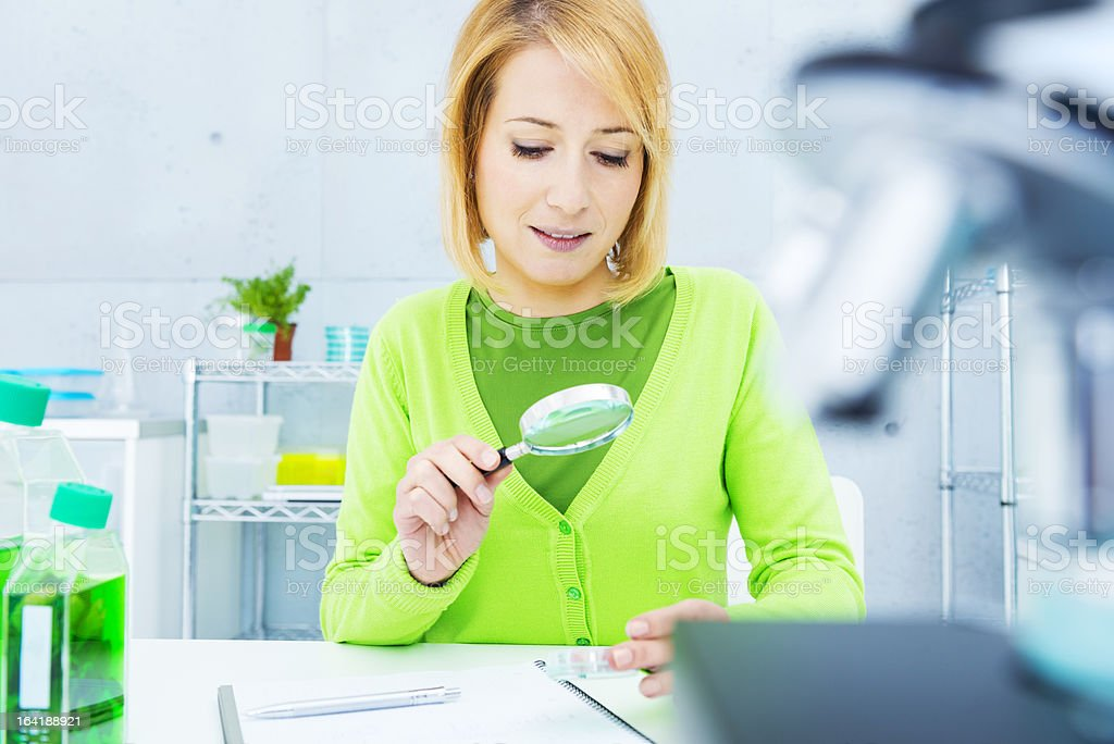 Investigating in a biology laboratory. royalty-free stock photo