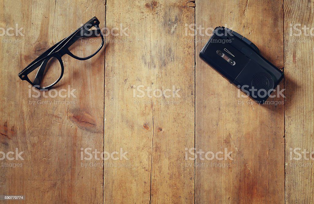investigation concept. tape recorder and glasses stock photo
