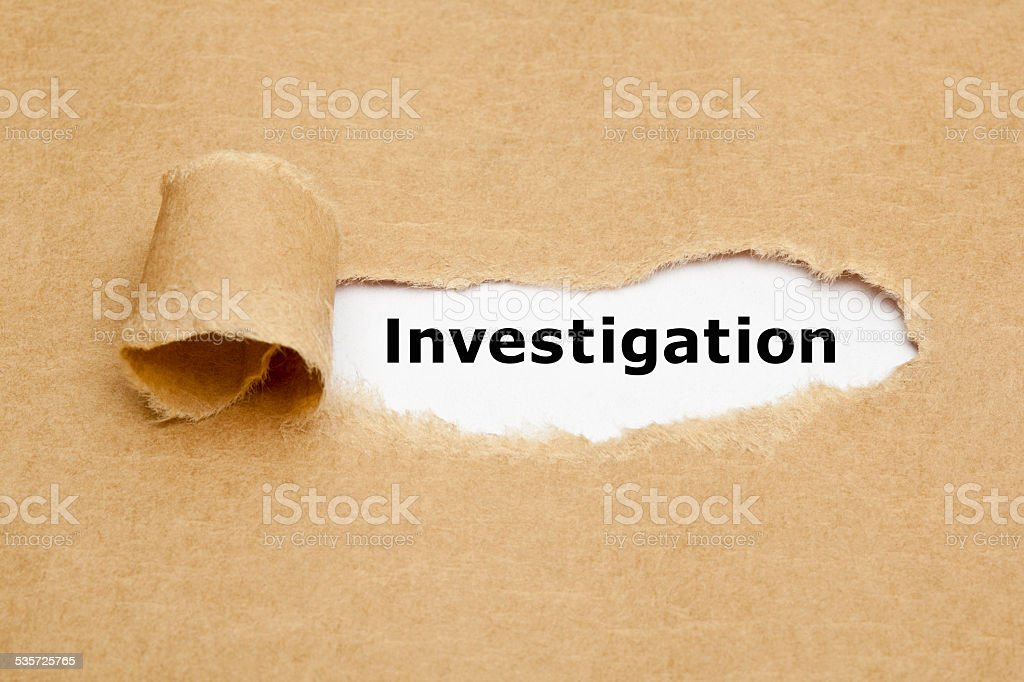 Investigation Torn Paper Concept stock photo