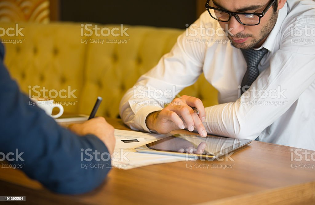 Investing with digital tablet stock photo