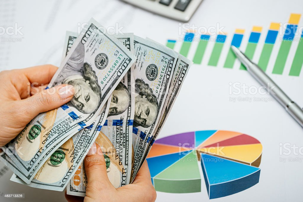 Investment and banking concept - businesswoman counting dollars stock photo