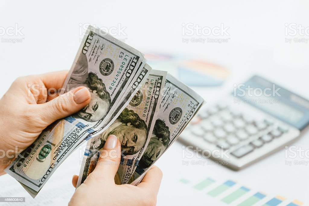 Investment and banking concept - businesswoman with dollars in office stock photo
