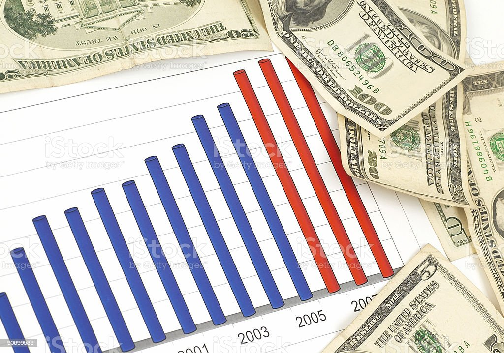 Investment chart surrounded by money stock photo