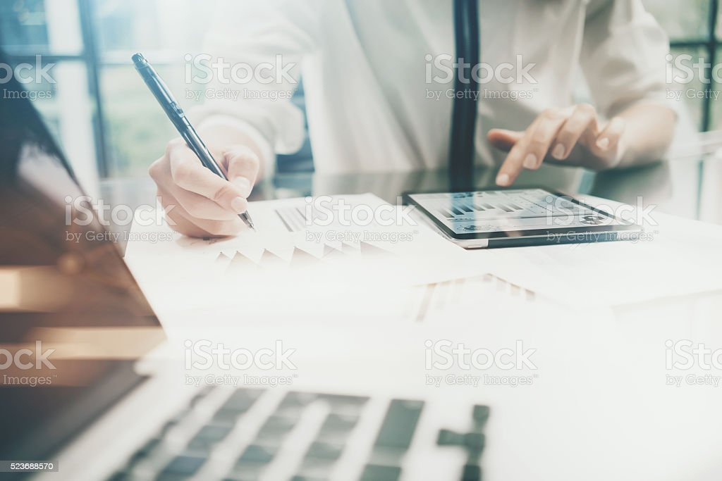 Investment manager work process.Photo business woman touchig modern tablet stock photo