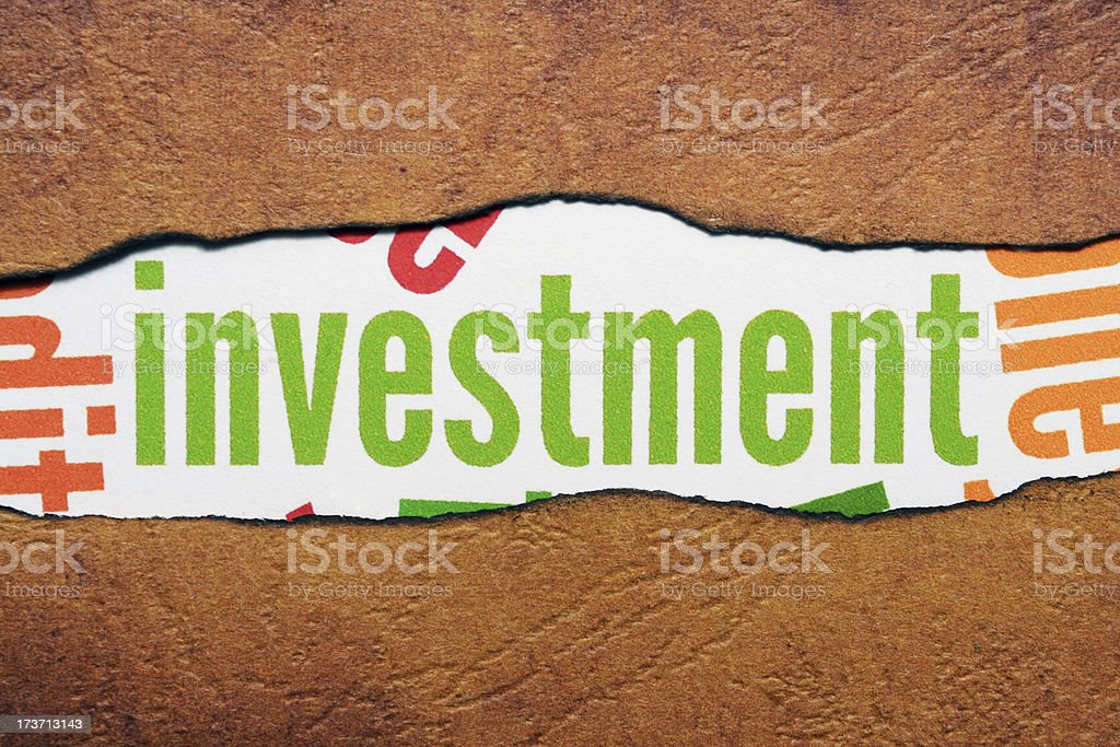 Investment text on torn paper royalty-free stock photo