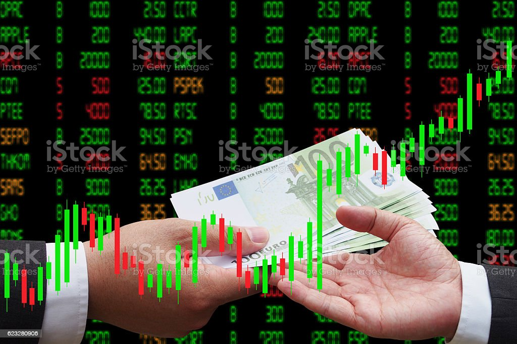 Investor giving euro money to his business partner Candlestick Chart stock photo