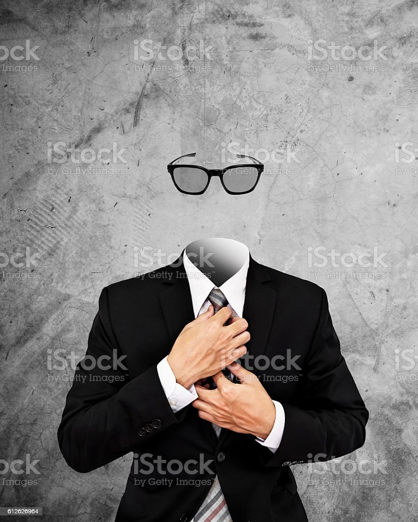 Invisible businessman with sunglasses, on concrete wall stock photo
