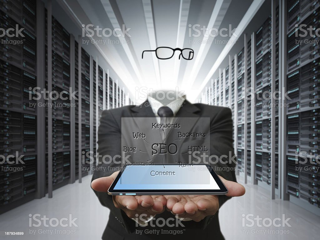 invisible man hold tablet and SEO diagram as concept royalty-free stock photo