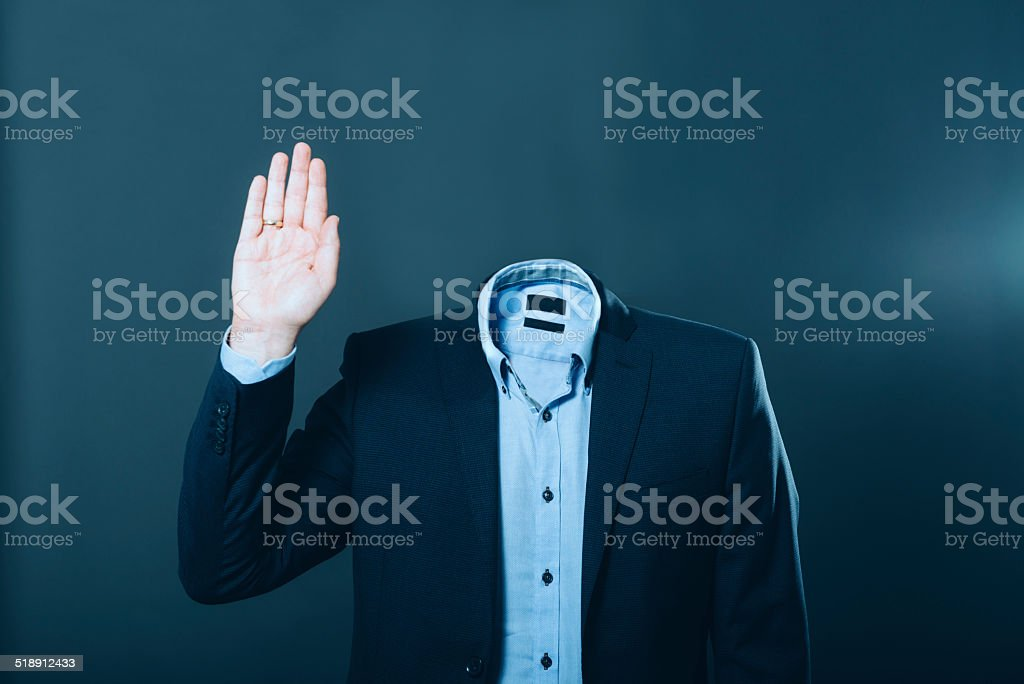 Invisible man wearing a suit and waving his hand stock photo