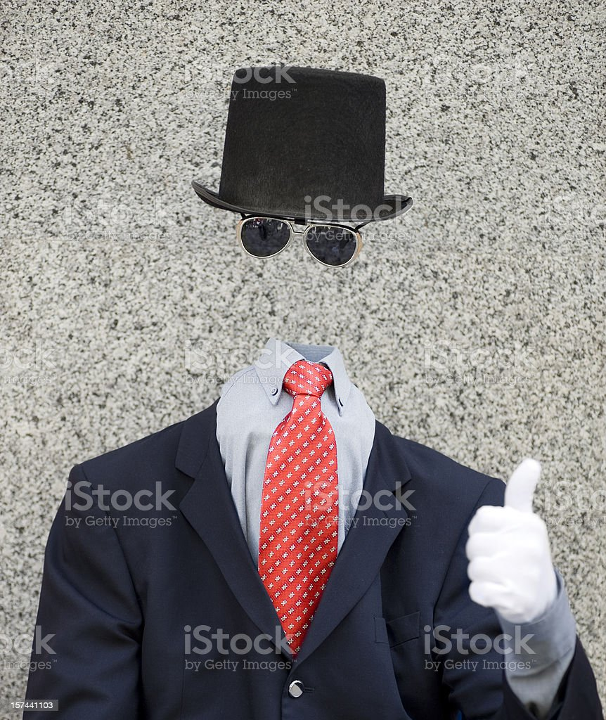 Invisible man wearing suit and hat with thumbs up sign stock photo