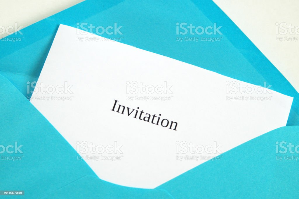 Invitation card printed on white paper in blue envelope, white background stock photo