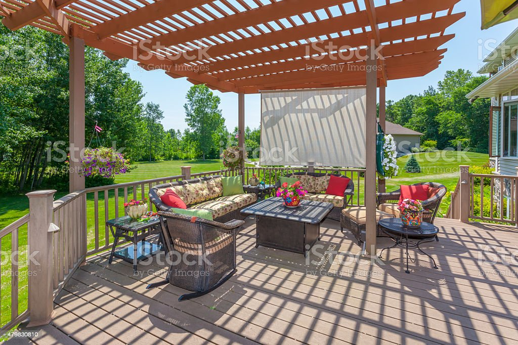 Inviting Backyard Patio Deck With Pergola stock photo