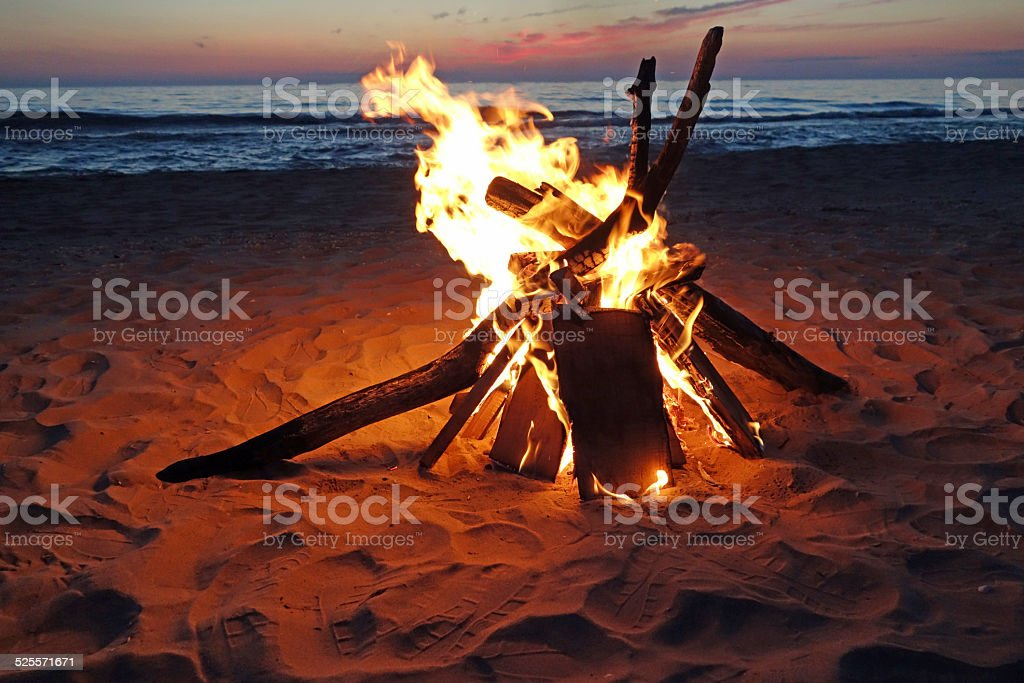 Inviting campfire on the beach stock photo