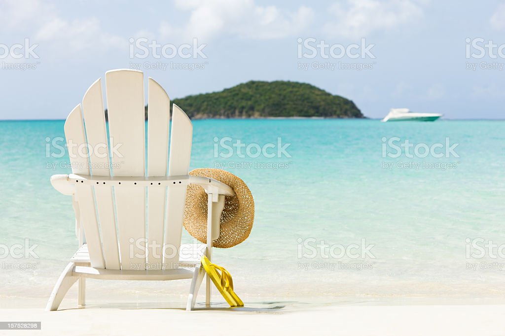 inviting chair on a tropical beach stock photo