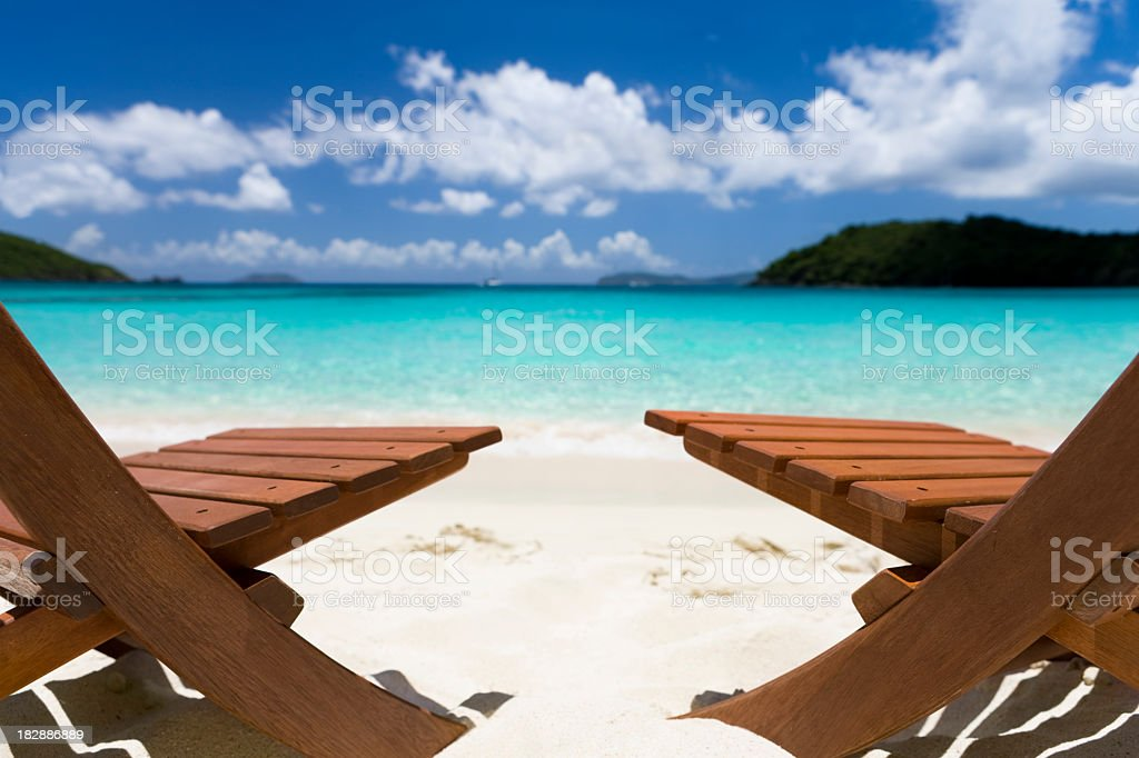 inviting chairs on a beautiful beach in the Caribbean royalty-free stock photo