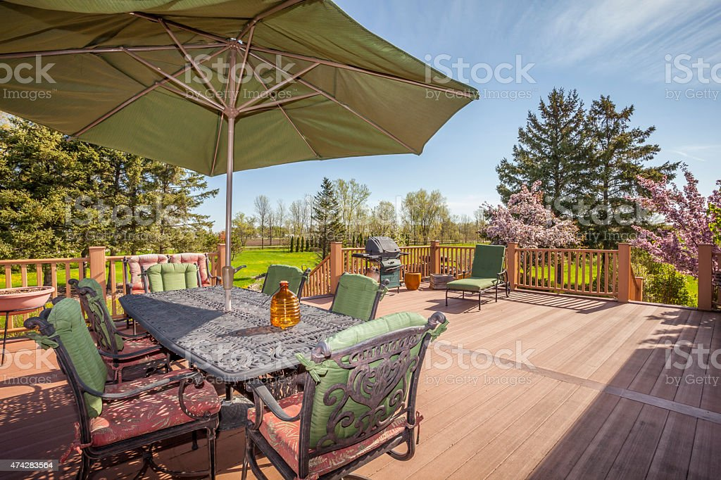 Inviting Rural Deck and Back Yard in Springtime stock photo