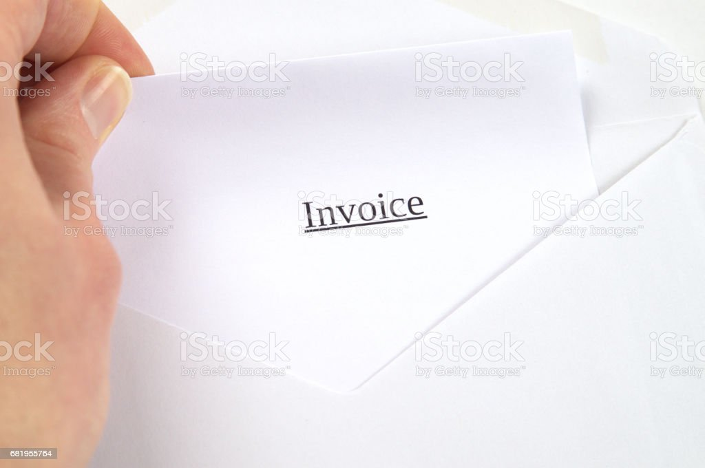 Invoice printed on white paper and envelope, hand opening it, white background stock photo