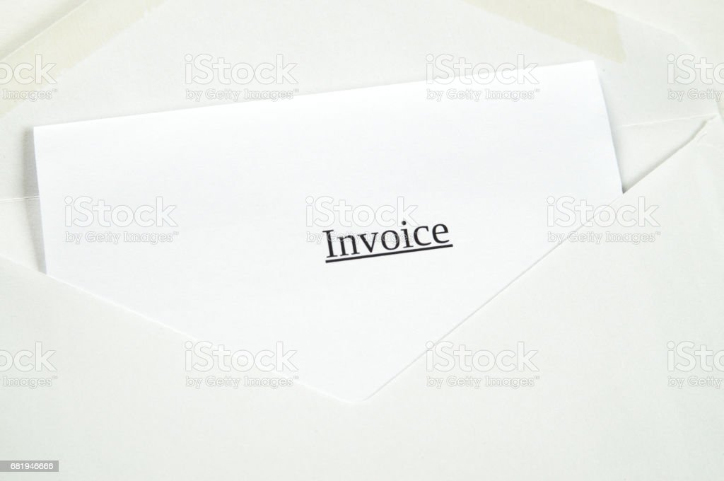 Invoice printed on white paper and envelope, white background stock photo