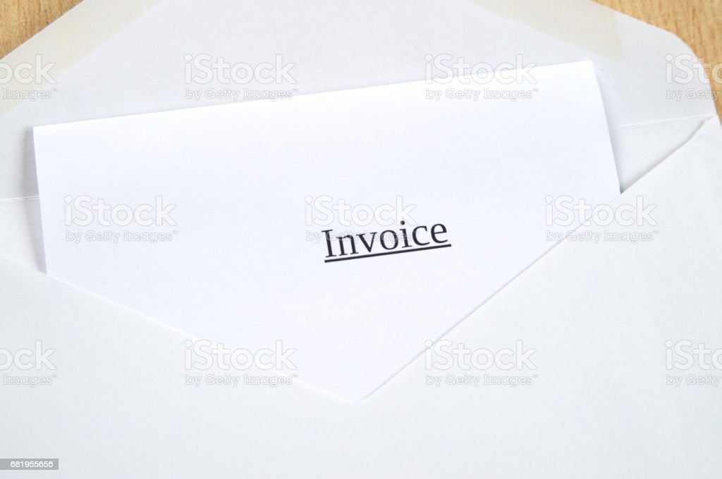 Invoice printed on white paper and envelope, wooden background stock photo