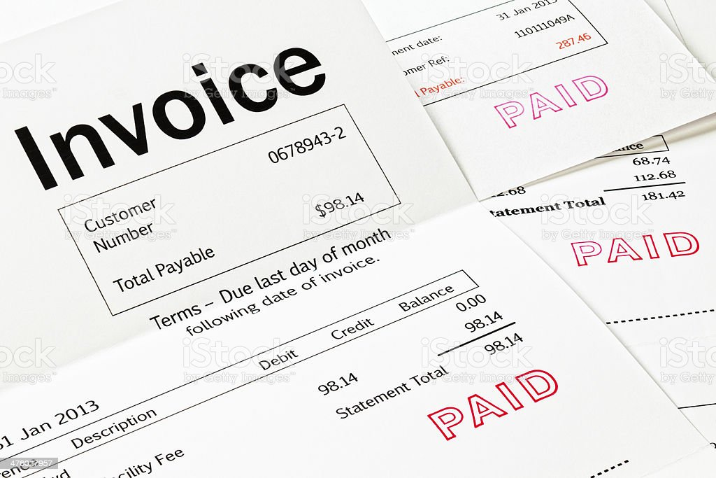 Invoice with Paid Stamp stock photo