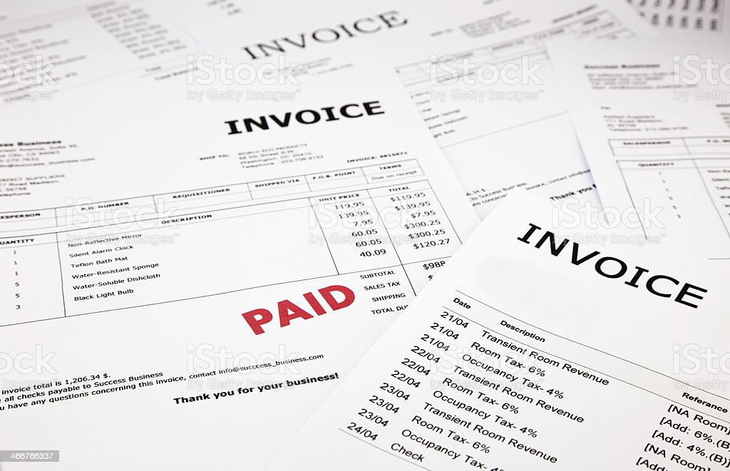 Invoices and bills with paid stamp stock photo