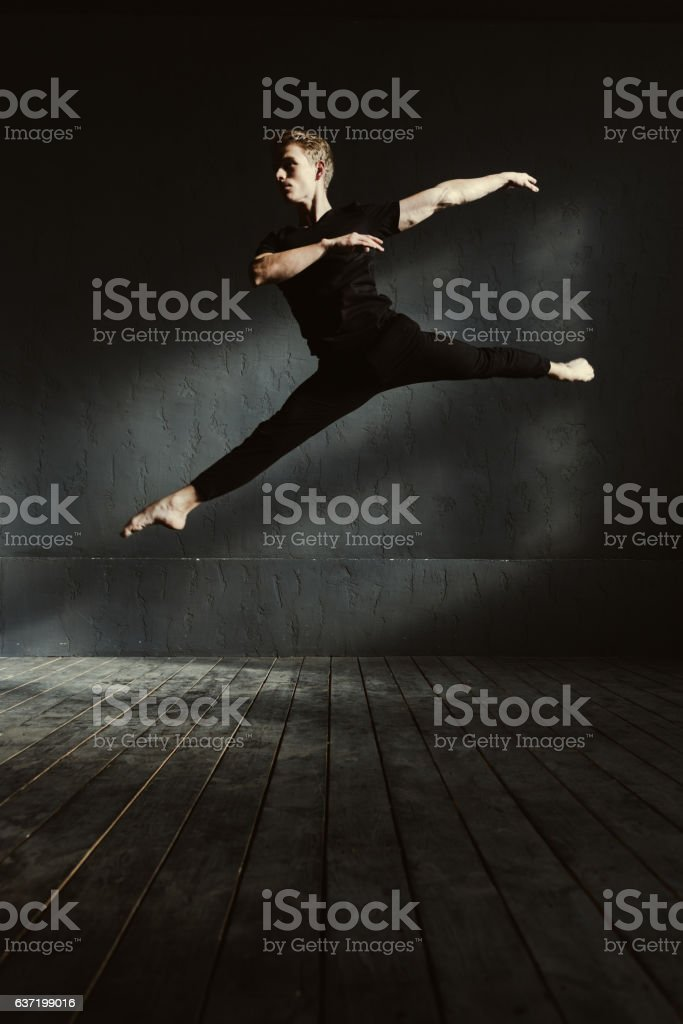 Involved ballet dancer stretching in the air stock photo
